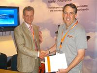 Dr. Andrew Shubin of NT-MDT (Russia) and Dr. Ken Williams of Renishaw plc (UK) signing the OEM agreement